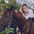 Stock Photo: Fiancee in wedding dress astride on horse