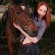 Girl in a shirt and a horse — Stock Photo