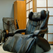 Black massage chair - Stock Photo