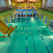 Swimming pool in aqua center - Stock Photo
