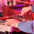 Dj mixes track in nightclub at party — Stock Photo #19567991
