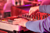 Dj mixes the track in the nightclub at a party — Stock Photo