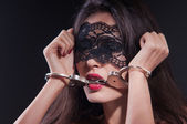 Dominating beauty in handcuffs — Stock fotografie