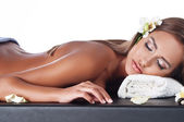 Female during luxurious procedure of massage — Stock Photo