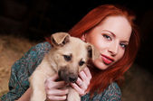 Young woman playing with her dog — Stock Photo