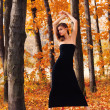 Hot young woman in autumn park — Stock Photo