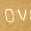 Inscription love on the sand - Stock Photo