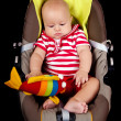Portrait of happy little baby boy in stroller. — Stock Photo