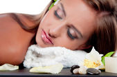 Female during luxurious procedure of massage — Stockfoto