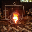 Foundry - molten metal poured from ladle into mould — Foto Stock