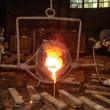 Foundry - molten metal poured from ladle into mould — Stok fotoğraf