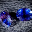 Blue diamonds isolated on a black background. — Stock Photo