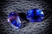 Blue diamonds isolated on a black background. — Stockfoto
