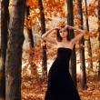 Stock Photo: Hot young woman in autumn park