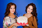 Two young happy woman with a gift — Stock Photo