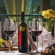Wine and grapes and cheese on the table — Stock Photo