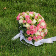 Wedding bouquet from roses in a grass — Stock Photo