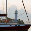Yacht and lighthouse — Stock Photo #4631546