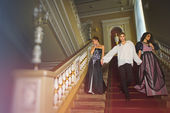 Beautiful two women and a man in the clothing of the 18th centur — Stock Photo