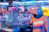 Male DJ stands for remote control indoor nightclub — Stock Photo