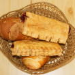 Bread and pies in basket — Stock Photo