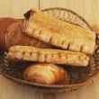 Bread and sweet pies in basket — Stock Photo