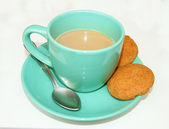 Drink coffee and cookie on white background — Stock Photo