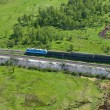 Moving train on the Trans Siberian railroad - Stock Photo