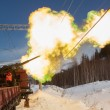 Shooting a cannon on railroad - Stock Photo