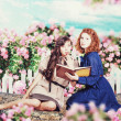 Art collage with beautiful women in garden — ストック写真
