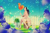 Beautiful woman in fairy garden — Stock Photo