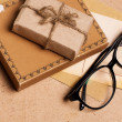 Present gift from grunge paper with glasses — Stock Photo #4678477