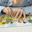 Assembling puzzle — Stock Photo