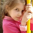 Small pretty girl at the playground — Stock Photo
