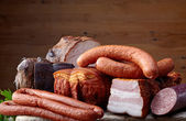 Smoked meat and sausages — Stok fotoğraf