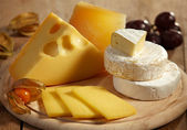 Cheese and fruits — Stock Photo
