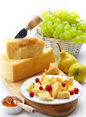 Parmesan cheese and fruits — Stock Photo
