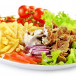 Plate of kebab and vegetables — Stock Photo #17675805