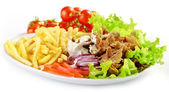 Plate of kebab and vegetables — Stock Photo