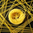 Stock Photo: Spaghetti on black background