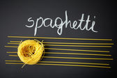 Spaghetti on black background — Stock Photo