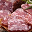 Salami sausage and bread — Stock Photo #19894345