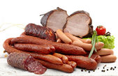 Smoked meat and sausages salami — Stock Photo
