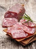 Salami sausage and bread — Stock Photo
