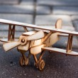 Wooden toy airplane - Stock Photo