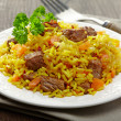 Stock Photo: Uzbek national dish plov on plate