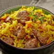 Uzbek national dish plov in a bowl — Stock Photo