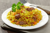 Uzbek national dish plov on plate — Stock Photo