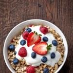 Bowl of muesli and yogurt with fresh berries — Stock Photo #23140058