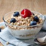 Bowl of muesli and yogurt with fresh berries — Stock Photo #23140068